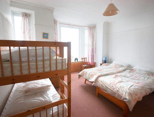 1st floor bedroom with sea views and en-suite