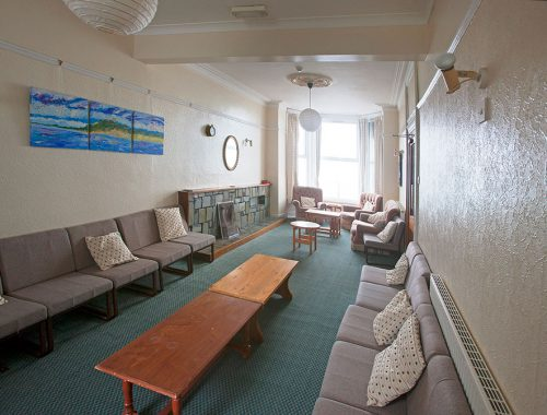 The lounge with bay window looking over Cardigan Bay